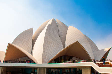 lotus temple: The Lotus Temple, located in New Delhi, India, is a Bahai House of Worship on the background of blue sky