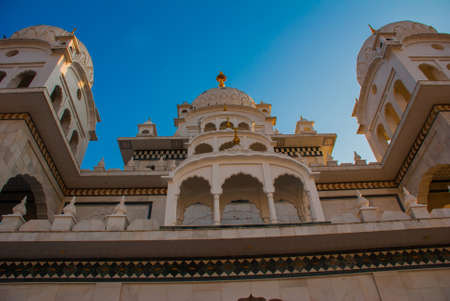 dome of hindu temple: An ancient Hindu temple in Pushkar in India. Temple on a background blue sky.