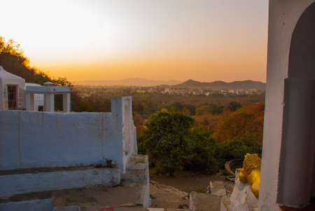 devout: Pushkar is a city in the Ajmer district in Rajasthan, India. It is one of the five sacred dhams for devout Hindus. It is one of the oldest existing cities of India. Stock Photo