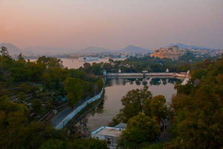 Lake, house and mountains on the horizon. Beautiful view of the city. Panorama city Udaipur, India Stock Photo