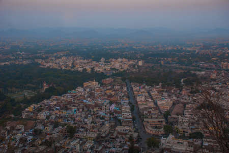 rajhastan: Beautiful view of the city. House, mountains on the horizon. Panorama city Udaipur, India Stock Photo