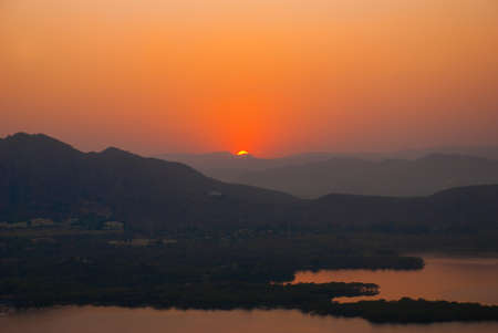 rajhastan: Lake, house and mountains on the horizon. Beautiful view of the city. Panorama city Udaipur, India Stock Photo
