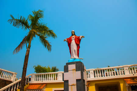 resurrect: Jesus Christ statue. Fort Tiracol. Catholic Church against the blue sky. Goa. India