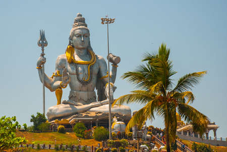 karnataka culture: Statue of Lord Shiva was built at Murudeshwar temple on the top of hillock which overlooks the Arabian Sea and it is 37 meters in height. Murudeshwar. Karnataka, India