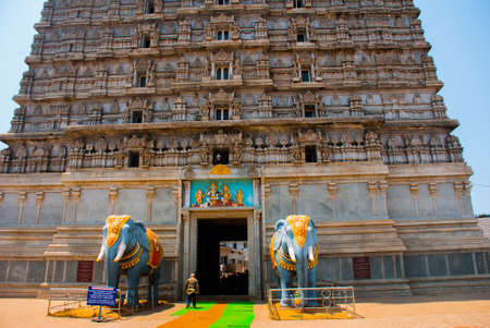 karnataka culture: Beautiful high tower, with a height of 184 meters. The entrance is decorated with two colorful statues of elephants. Raja Gopuram Tower. Murudeshwar. Karnataka, India Stock Photo