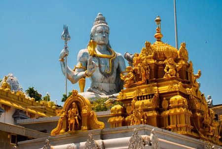 karnataka culture: Statue of Lord Shiva. An old Hindu temple with architectural Golden detail. Murudeshwar. Karnataka, India