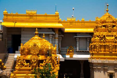 the gilding: Old temple with beautiful decoration and gilding. Murudeshwar. Karnataka, India