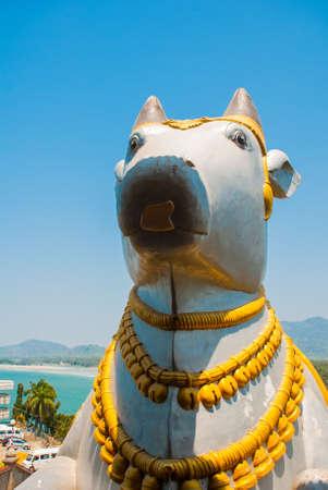 karnataka culture: Large gold statues. Fragment of the architectural ensemble. Statue of Lord Shiva. Murudeshwar. Karnataka, India