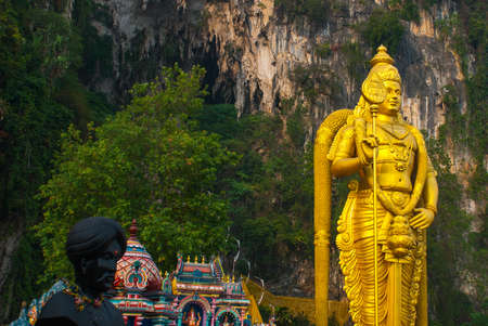 colossal: The Batu Caves and the colossal statue of Lord Murugan in Kuala Lumpur, Malaysia. Stock Photo