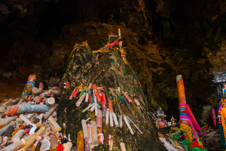 phra nang: Revered wooden phalluses. Railay Peninsula on whose territory the cave Phra Nang Cave. Krabi, Thailand. Stock Photo