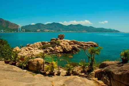sea cliff: Beautiful sea the mountains on the horizon.The garden of stones, popular tourist destinations at Nha Trang. Vietnam