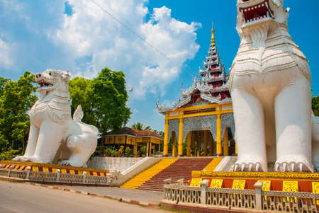 adorned: Chinthe. The entrance is adorned by huge statues of animals., Mandalay, Myanmar. Burma.
