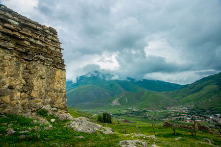 caucas: City of the dead.Stone ancestral tombs on the hill with mountains in the background, inside the bone. The Caucasus.Russia.