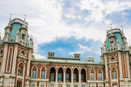 tsaritsyno: Tsaritsyno palace in Moscow, Russia. Brick historic building on the background of blue sky with white clouds in summer.