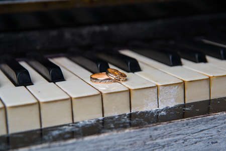 nuptials: Two beautiful wedding rings lie on black and white keys of the piano