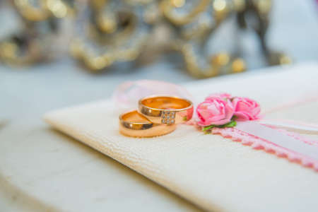Two beautiful wedding gold rings with diamonds