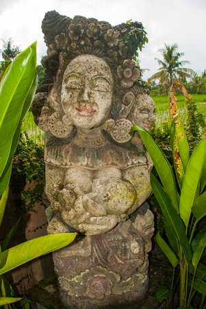 ubud: Small traditional Balinese sculpture of a mother with a child. Bali. Indonesia. Stock Photo