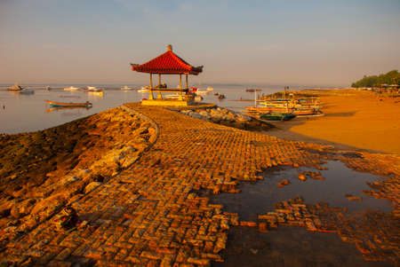 Traditional Balinese ships Jukung in Sanur beach at sunrise, Bali, Indonesia