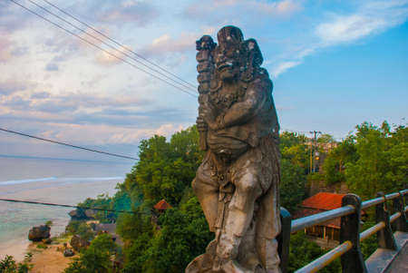 Pabang Pabang beach, where they filmed the movie Eat, pray, love Julia Roberts. Bali, Indonesia.Beautiful beach, view from the bridge with the sculpture of the spirit before sunset. Stock Photo