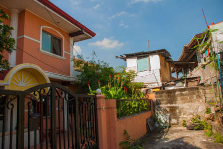 Ordinary Local street with houses in the capital of the Philippines Manila