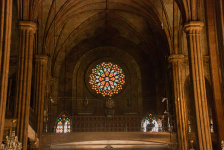 Beautiful Catholic Cathedral in the capital Manila, Philippines.Interior. Stained glass in the window Stock Photo