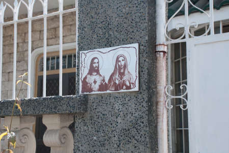 unicef: The picture at the entrance to the house of Jesus Christ and mother of God. Philippines. Manila. Local street