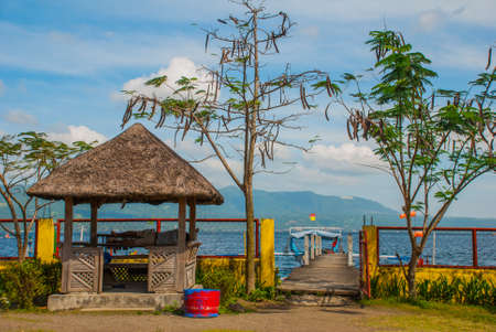 small gazebo and trees at the pier. Taal Lake, Tagaytay Philippines.
