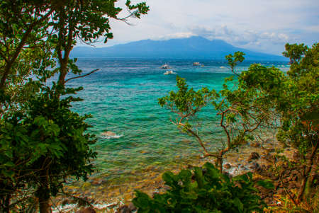 Apo island,Philippines, view on island beach line: mountain, sea and boats, the view from the top. Stok Fotoğraf