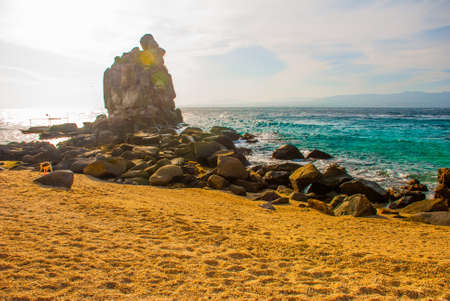 Apo island,Philippines, view on island beach line. Sea, sand rocks Stock Photo