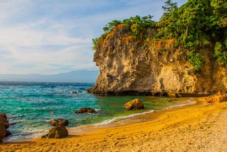Apo island,Philippines, view on island beach line. Sea, sand rocks Stok Fotoğraf