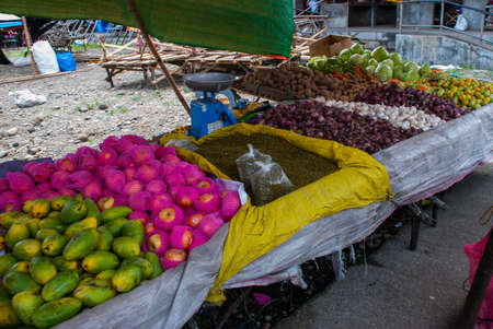 Selling fruits at a market in the Philippines. Sale Mango, apples, garlic, seeds. Pandan, Panay island Stock Photo