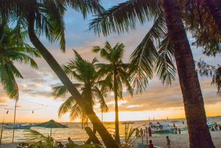 lia: Beautiful tropical landscape with palm trees in the evenin. Boracay island, Philippines Stock Photo