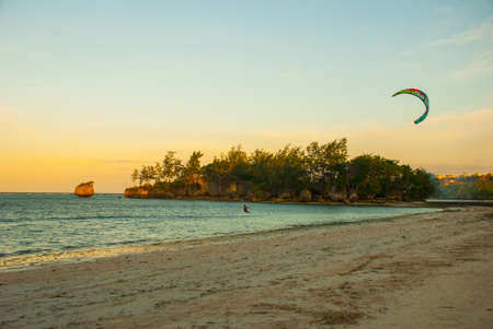 Evening landscape of a small island and the sea. Boracay island, Bulabog beach, Philippines