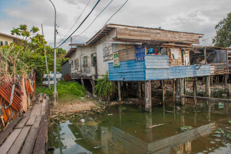 Homes on stilts. Wooden bridges in the poor district. Kota Kinabalu, Sabah, Malaysia.