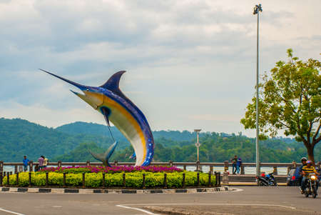The fish sculpture on the waterfront. landmark I Love KK pictured. Kota Kinabalu Sabah Malaysia