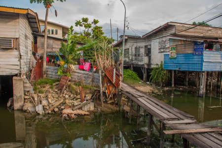 mabul: Homes on stilts. Wooden bridges in the poor district. Kota Kinabalu, Sabah, Malaysia.