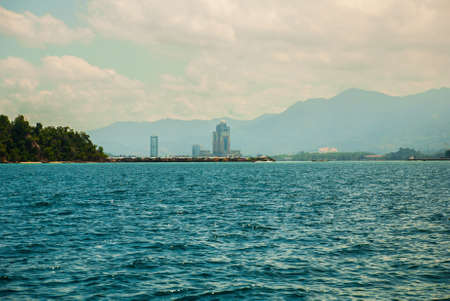 The view from the boat on the sea and the city. Kota Kinabalu, Sabah, Malaysia.