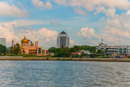 Kuching City Mosqueat day time, Sarawak, Malaysia. Masjid Bahagian. The view from the water to the pink mosque