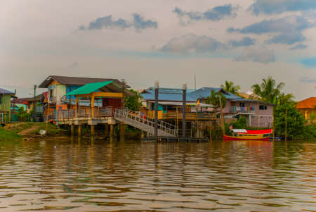 A village by the river in Sarawak, Kuching, Malaysia. Landscape view of the local house