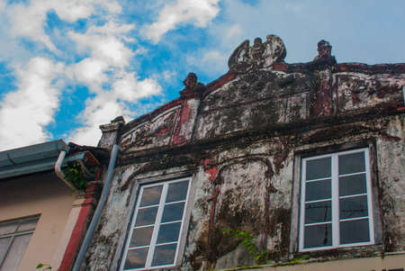 Strange and ancient, old building in Kuching with a spiral staircase. Sarawak Borneo Malaysia Stock Photo