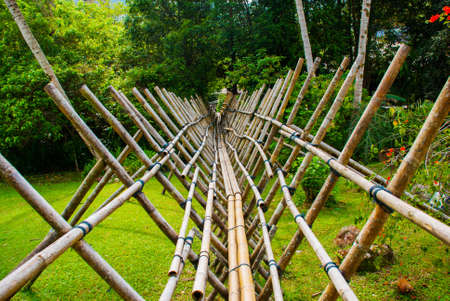 Traditional bamboo bridge to be crossed by the visitors to enter deviate Culture Village. Borneo, Sarawak, Malaysia