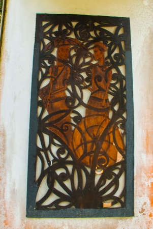 blowpipe: Fragment wood carving. The main entrance of the Kuching to Sarawak Culture village. Borneo, Malaysia