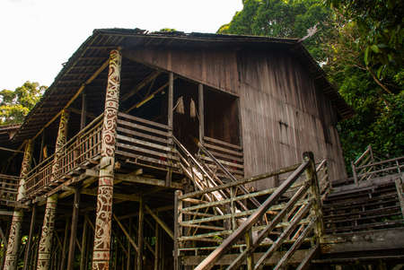 Traditional wooden houses Rumah Orang Ulu in the Kuching to Sarawak Culture village. Borneo, Malaysia