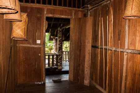 Traditional wooden houses in the Kuching to Sarawak Culture village. The interior life of people. Borneo, Malaysia