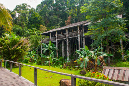 Traditional wooden houses Rumah Orang Ulu in the Kuching to Sarawak Culture village. Borneo, Malaysia Stock Photo