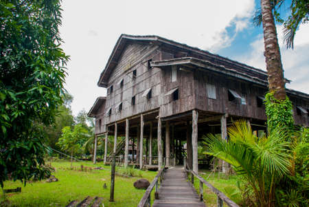 Traditional wooden houses Nelanau Yall in the Kuching to Sarawak Culture village. Borneo, Malaysia Stock Photo