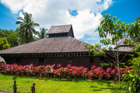 Traditional wooden houses in the Kuching to Sarawak Culture village. Orang-ulu longhouse. Borneo, Malaysia