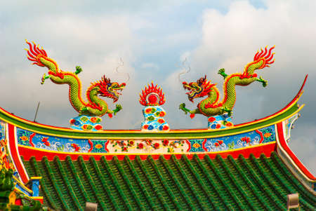 Multi-colored dragons on the roof. Beautiful Chinese Temple Tua Pek Kong. Miri city, Borneo, Sarawak, Malaysia