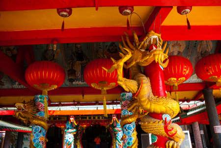 Golden dragon on the pole. Red Chinese lantern. Beautiful Temple Tua Pek Kong. Miri city, Borneo, Sarawak, Malaysia