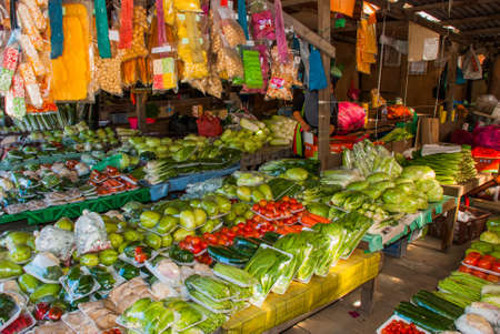 The traditional Asian market with food. Sale a variety of vegetables lying on the counter. Malaysia Stock Photo